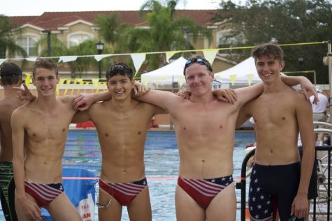 From left to right: Cobyn Panerelli, 11; Alex Espinosa, 12; Jacob Schuster, 12; Aidan Boggs, 12. The 200-yard freestyle relay placed second.