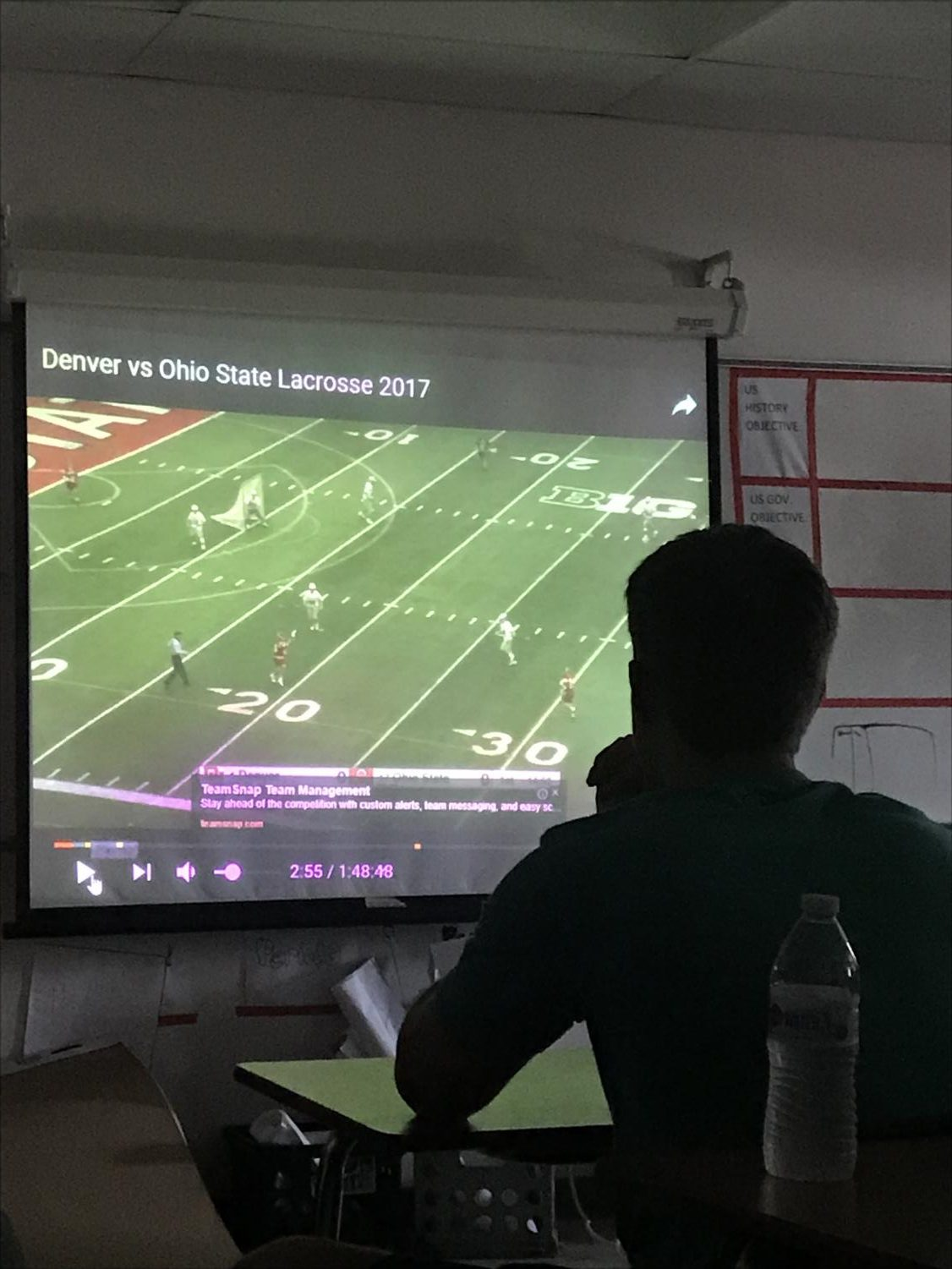 As part of their training, the boys LAX team watches videos of college lacrosse teams.